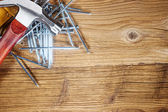 Tools on old wood table — Stock fotografie