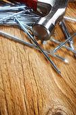 Hammer and nails on wood — Zdjęcie stockowe