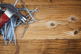 Steel nails on old wood — Stock Photo