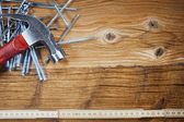 Hammer, nails, ruler on wood — Foto Stock