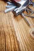 Hammer and nails on wood — Stock Photo