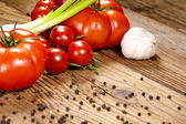 Red tomatoes with pepper and garlic — Stock Photo
