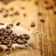 Fresh coffee beans on wood background, Macro close-up for design — Stock Photo #39674549