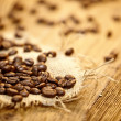 Fresh coffee beans on wood background, Macro close-up for design — Stock Photo #39674571