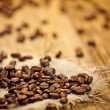 Fresh coffee beans on wood background, Macro close-up for design — Stock Photo #39674585