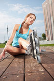 Active young people - girl rollerblading — Stockfoto