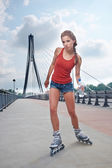 Active young people - girl rollerblading — 图库照片