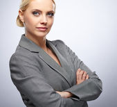 Portrait of a beautiful young business woman standing against gr — Stock Photo