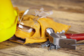 Yellow helmet and tool belt. — Stock Photo