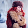 Stock Photo: Girl with red hair in winter