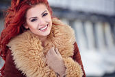 Girl with red hair in the winter — Stock Photo