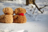 Teddy bears on a snow around each — Stock Photo