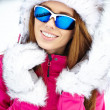 Woman wearing ski goggles — Stock Photo