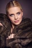 Woman wearing fashionable fur — Stock Photo