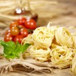 Vine tomatoes, basil, spaghetti — Stock Photo #40831559