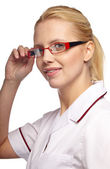 Female doctor smiling with glasses — Stock Photo