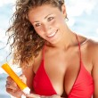 Stock Photo: Womapplying sun block solar cream for UV protection