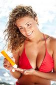 Woman applying sun block solar cream for UV protection — Stock Photo