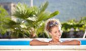 Sexy girl in bikini lying near swimming pool. — Stock Photo