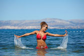Bikini model splashing water — Stock Photo