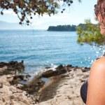 Woman in bikini near edge of infinity pool — Stock Photo #41538439