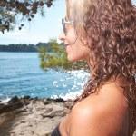 Woman in bikini near edge of infinity pool — Stock Photo #41538441