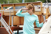 Fashion woman at the wooden old Yacht — Stock Photo