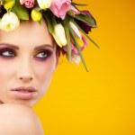 Spring girl wearing flowers hat — Stock Photo #42379919