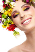 Portrait of a beautiful spring girl wearing flowers hat. Studio — Stock Photo
