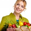 Woman holding a bag full of healthy food — Stock Photo