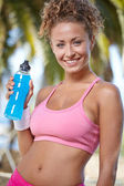 Sporty woman with bottle of water — Stock Photo