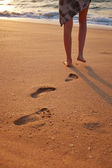 Footprints on the beach sand — Stock Photo