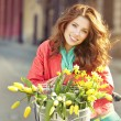 Girl on bicycle with spring flower — Stock Photo #46247851
