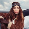 Woman pilot in front of airplane — Stock Photo #48093685
