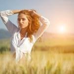 Woman in wheat field enjoying — Stock Photo #49204089