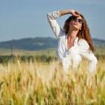 Woman in wheat field enjoying — Stock Photo #49204129