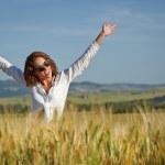 Woman in wheat field enjoying — Stock Photo #49204147