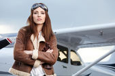 Woman pilot in front of airplane — Stock Photo