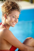 Sexy  model posing by the pool — Stock Photo