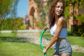 Woman having fun in summer garden — Stock Photo
