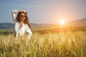 Woman in wheat field enjoying — Stock Photo
