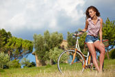 Woman with vintage bike — Foto Stock
