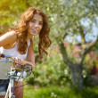 Woman with bike in a country road — Stock Photo #49622775