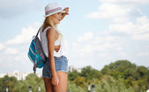 Beautiful tourist with a backpack — Stock Photo