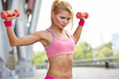 Fitness instructor exercising with weights — Stock Photo