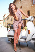 Woman on scooter on the streets — Stock Photo