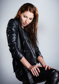 The girl in black leather jacket — Stock Photo