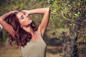 Woman under an olive tree — Stock Photo
