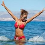 Bikini model splashing water — Stock Photo #50685971