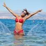 Bikini model splashing water — Stock Photo